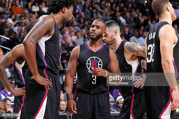 Chris Paul of the LA Clippers talks with teammate DeAndre Jordan against the Sacramento Kings on October 18 2016 at Golden 1 Center in Sacramento...