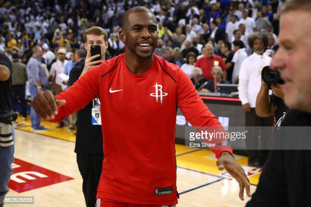 Chris Paul of the Houston Rockets celebrates after defeating the Golden State Warriors 122121 in their NBA game at ORACLE Arena on October 17 2017 in...