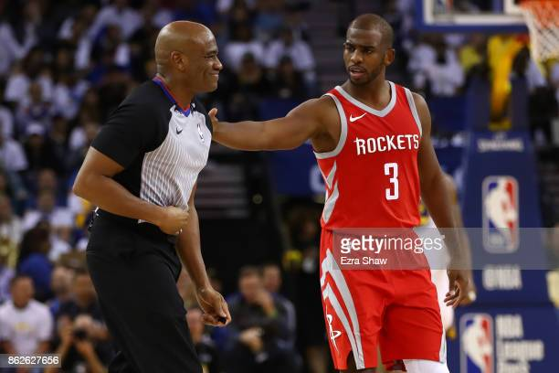 Chris Paul of the Houston Rockets checks on referee Tre Maddox after he fell during their NBA game against the Golden State Warriors at ORACLE Arena...
