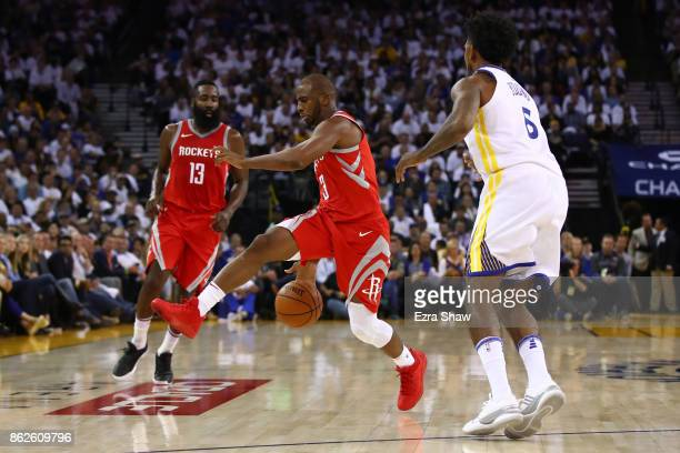 Chris Paul of the Houston Rockets controls the ball against the Golden State Warriors during their NBA game at ORACLE Arena on October 17 2017 in...