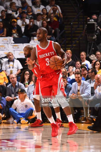 Chris Paul of the Houston Rockets handles the ball against the Golden State Warriors on October 17 2017 at ORACLE Arena in Oakland California NOTE TO...