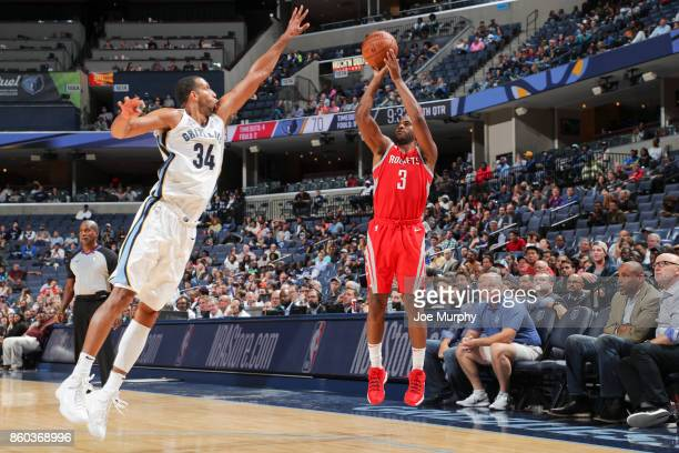Chris Paul of the Houston Rockets shoots the ball against Brandan Wright of the Memphis Grizzlies during a preseason game on October 11 2017 at...