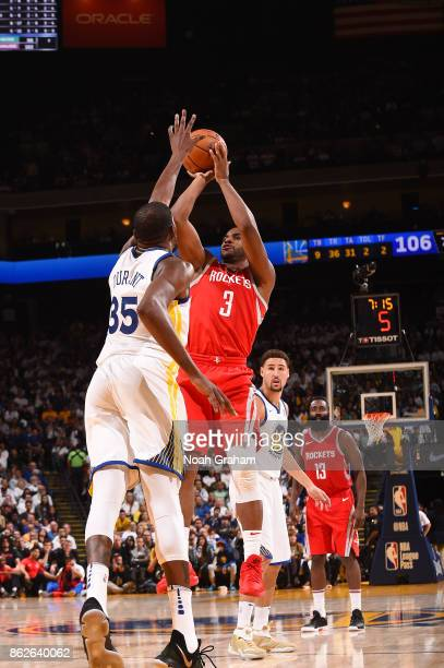 Chris Paul of the Houston Rockets shoots the ball against the Golden State Warriors on October 17 2017 at ORACLE Arena in Oakland California NOTE TO...