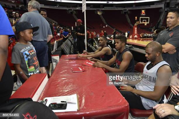Chris Paul of the Houston Rockets signs an autograph for a fan during the team's annual Fan Fest event on October 7 2017 at the Toyota Center in...