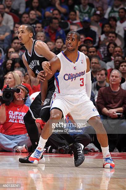 Chris Paul of the Los Angeles Clipper guards Shaun Livingston of the Brooklyn Nets on November 16 2013 at STAPLES Center in Los Angeles California...