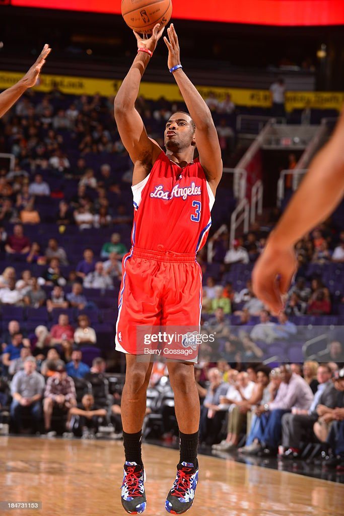 <a gi-track='captionPersonalityLinkClicked' href=/galleries/search?phrase=Chris+Paul&family=editorial&specificpeople=212762 ng-click='$event.stopPropagation()'>Chris Paul</a> #3 of the Los Angeles Clipper shoots against the Phoenix Suns on October 15, 2013 at U.S. Airways Center in Phoenix, Arizona.