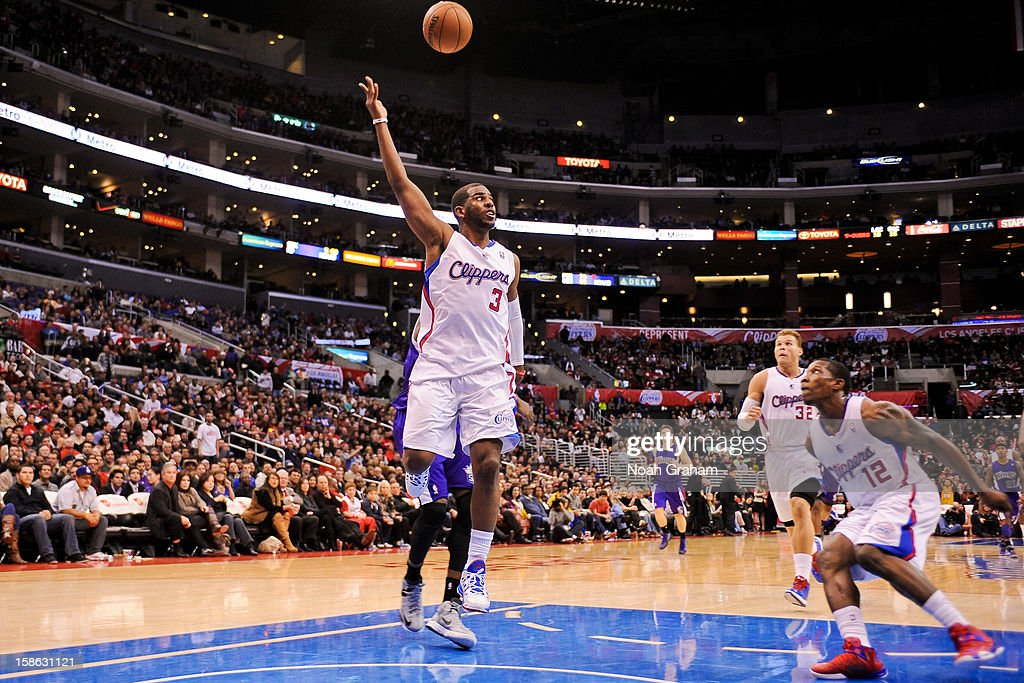 Chris Paul #3 of the Los Angeles Clippers alley-oop passes the ball to teammate Eric Bledsoe #12 for a dunk against the Sacramento Kings at Staples Center on December 21, 2012 in Los Angeles, California.