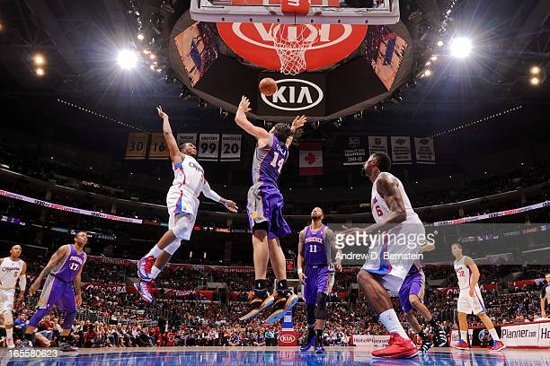 Chris Paul of the Los Angeles Clippers alleyoop passes the ball to teammate DeAndre Jordan against Luis Scola of the Phoenix Suns at Staples Center...