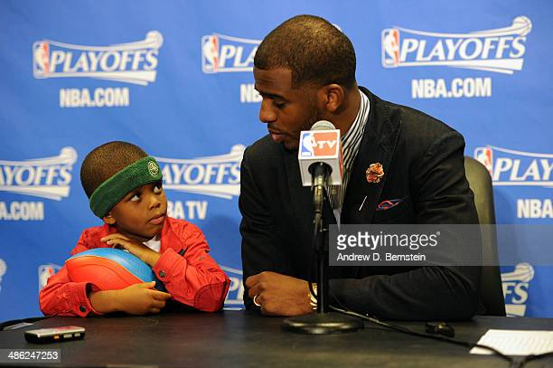 Chris Paul of the Los Angeles Clippers and his son Chris Paul II attend a post game press conference after Game Two of the Western Conference...