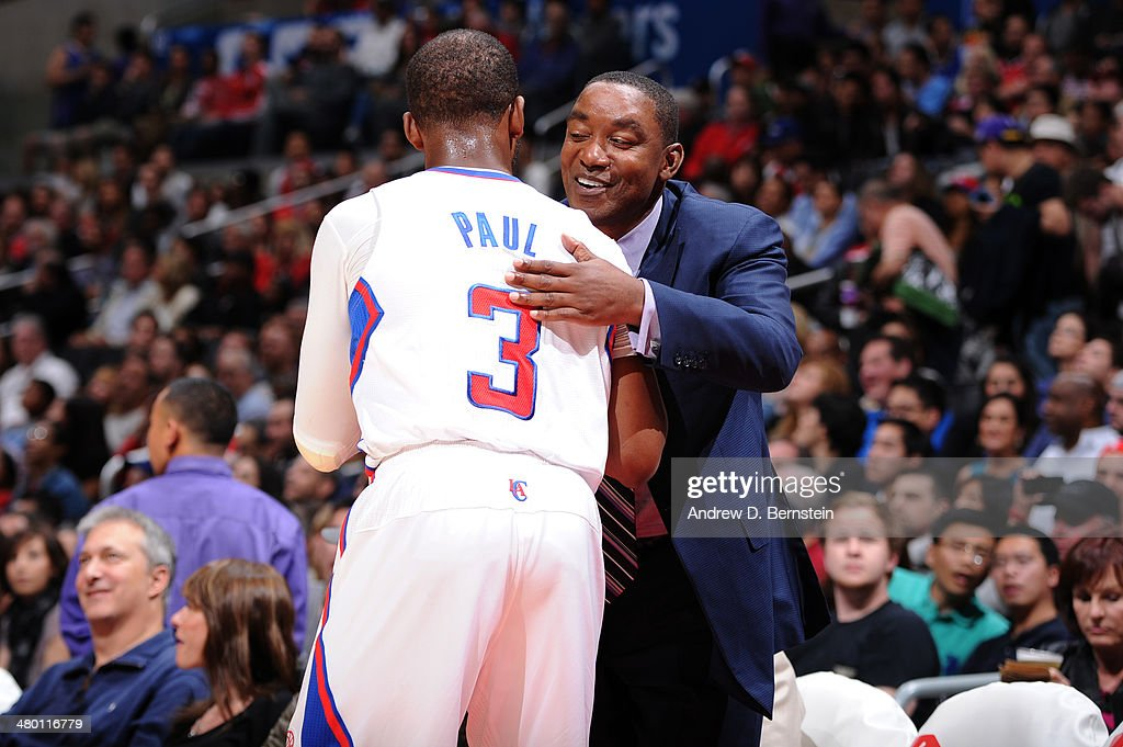 Chris Paul #3 of the Los Angeles Clippers and Isiah Thomas hug during a game between the Los Angeles Clippers and the Detroit Pistons at STAPLES Center on March 22, 2014 in Los Angeles, California.