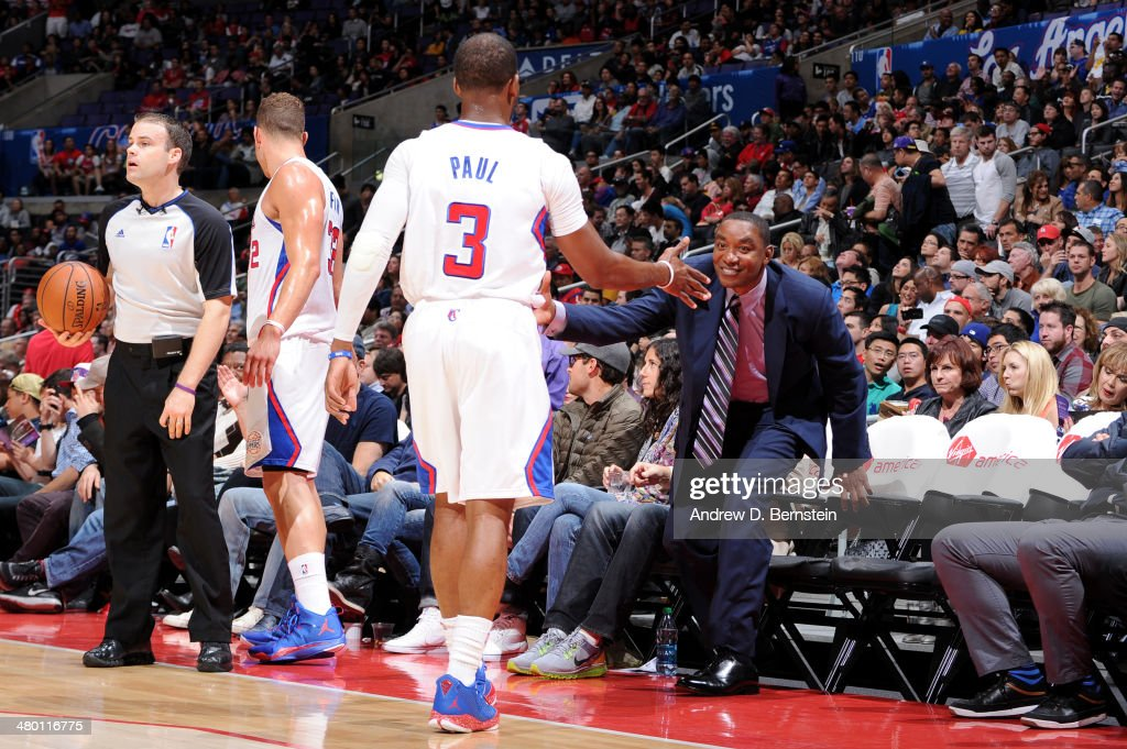Chris Paul #3 of the Los Angeles Clippers and Isiah Thomas shake hands during a game between the Los Angeles Clippers and the Detroit Pistons at STAPLES Center on March 22, 2014 in Los Angeles, California.