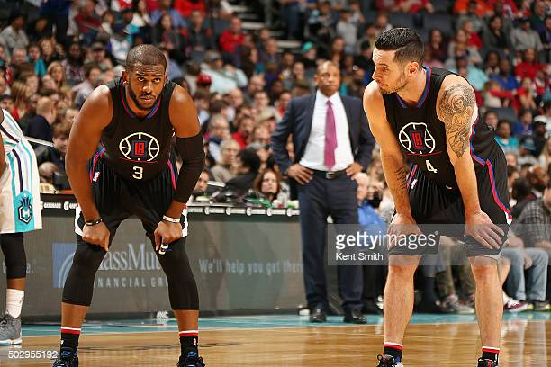 Chris Paul of the Los Angeles Clippers and JJ Redick of the Los Angeles Clippers stand on the court during the game against the Charlotte Hornets on...