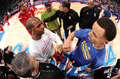 Chris Paul of the Los Angeles Clippers and Stephen Curry of the Golden State Warriors meet for the pre game captains meeting at STAPLES Center on...