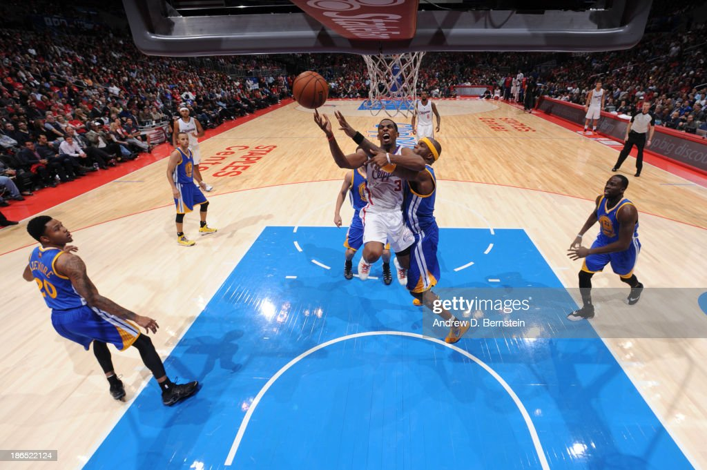 <a gi-track='captionPersonalityLinkClicked' href=/galleries/search?phrase=Chris+Paul&family=editorial&specificpeople=212762 ng-click='$event.stopPropagation()'>Chris Paul</a> #3 of the Los Angeles Clippers attempts a shot during a game against the Golden State Warriors at STAPLES Center on October 31, 2013 at in Los Angeles, California.