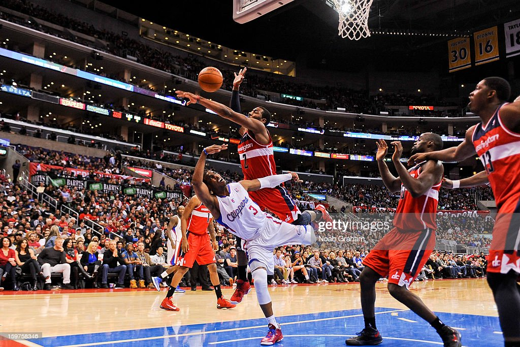 Chris Paul #3 of the Los Angeles Clippers attempts an off-balance shot against John Wall #2 of the Washington Wizards at Staples Center on January 19, 2013 in Los Angeles, California.