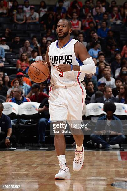 Chris Paul of the Los Angeles Clippers brings the ball up court against the Denver Nuggets during a preseason game on October 2 2015 at STAPLES...