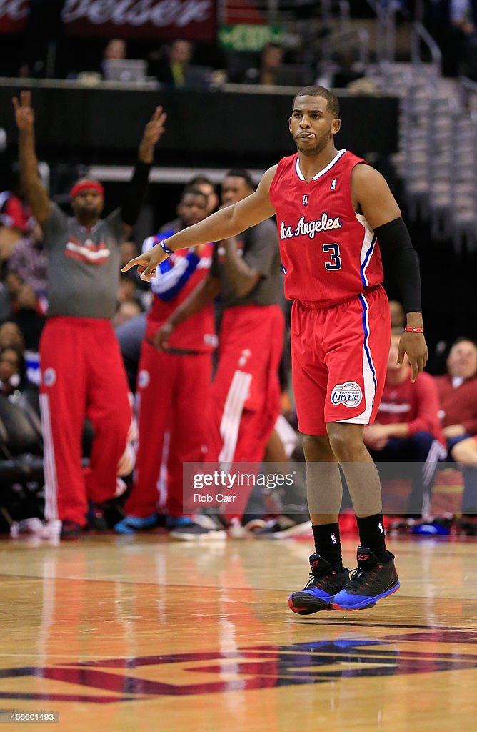 Chris Paul #3 of the Los Angeles Clippers celebrates after hitting a three pointer against the Washington Wizards during the second half of the Clippers 113-97 win at Verizon Center on December 14, 2013 in Washington, DC.