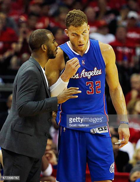 Chris Paul of the Los Angeles Clippers chats with teammate Blake Griffin on the court in the second half against the Houston Rockets during Game Two...