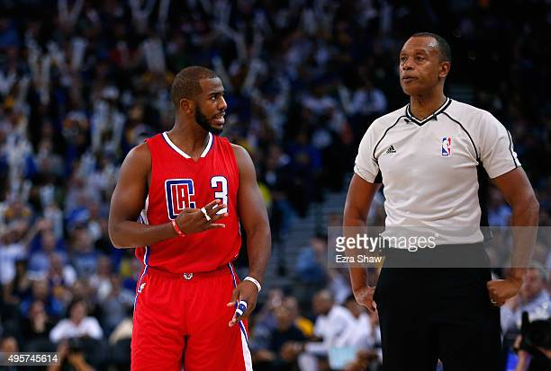 Chris Paul of the Los Angeles Clippers complains to referee Rodney Mott after he was called for a foul during their game against the Golden State...