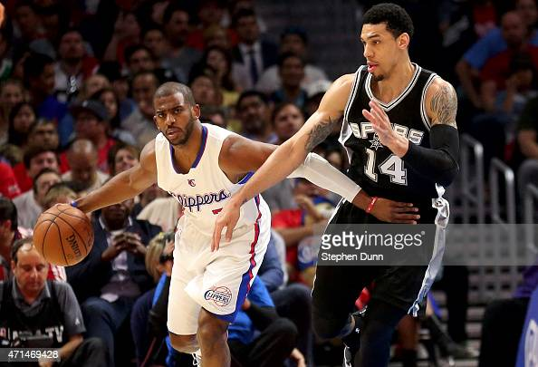 Chris Paul of the Los Angeles Clippers control the ball against Danny Green of the San Antonio Spurs during Game Five of the Western Conference...
