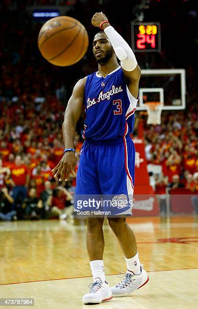 Chris Paul of the Los Angeles Clippers controls the ball against the Houston Rockets in the fourth quarter during Game Seven of the Western...