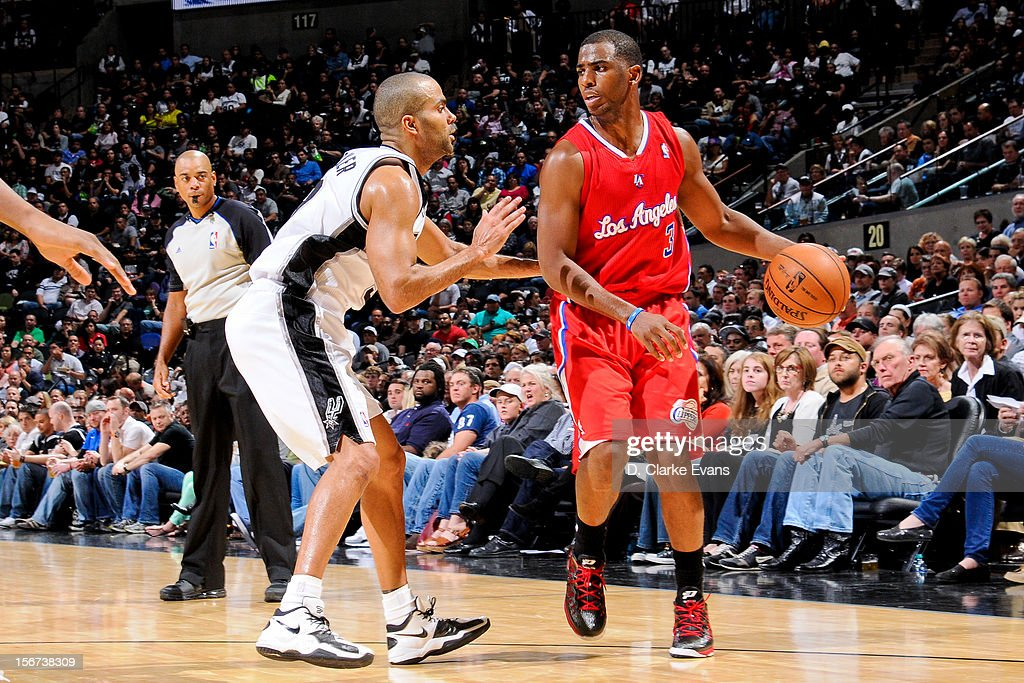 Chris Paul #3 of the Los Angeles Clippers controls the ball against Tony Parker #9 of the San Antonio Spurs on November 19, 2012 at the AT&T Center in San Antonio, Texas.