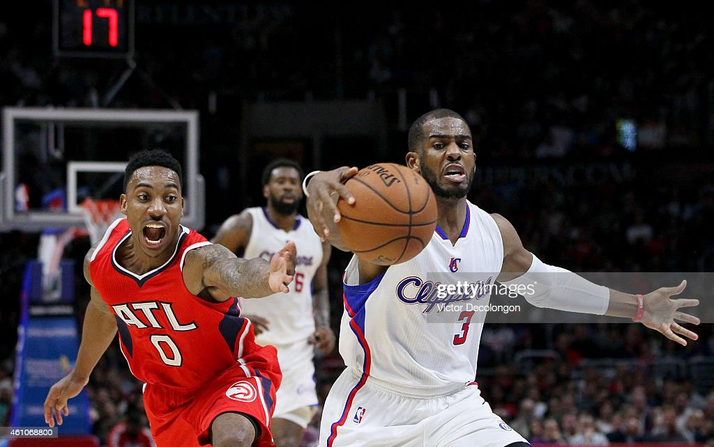 <a gi-track='captionPersonalityLinkClicked' href=/galleries/search?phrase=Chris+Paul&family=editorial&specificpeople=212762 ng-click='$event.stopPropagation()'>Chris Paul</a> #3 of the Los Angeles Clippers controls the ball before <a gi-track='captionPersonalityLinkClicked' href=/galleries/search?phrase=Jeff+Teague&family=editorial&specificpeople=4680498 ng-click='$event.stopPropagation()'>Jeff Teague</a> #0 of the Atlanta Hawks can get a hand on the ball in the first half during the NBA game at Staples Center on January 5, 2015 in Los Angeles, California.