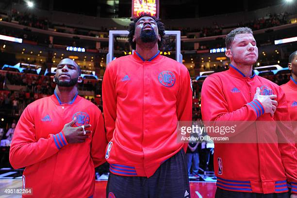 Chris Paul of the Los Angeles Clippers DeAndre Jordan of the Los Angeles Clippers and Blake Griffin of the Los Angeles Clippers stand for the...
