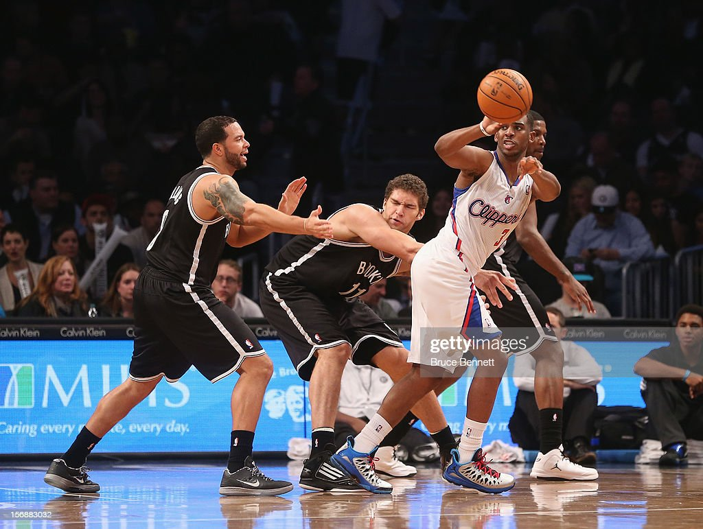 Chris Paul #3 of the Los Angeles Clippers dishes off the ball as he goes against Deron Williams #8 of the Brooklyn Nets at the Barclays Center on November 23, 2012 in the Brooklyn borough of New York City.