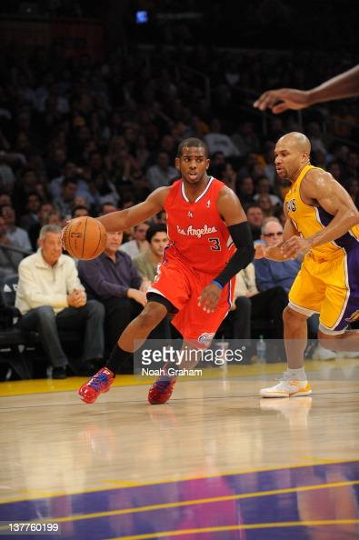 Chris Paul of the Los Angeles Clippers dribbles against Derek Fisher of the Los Angeles Lakers at Staples Center on January 25 2012 in Los Angeles...