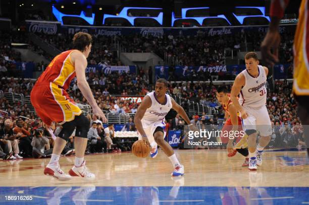 Chris Paul of the Los Angeles Clippers dribbles during a game against the Houston Rockets at Staples Center on November 4 2013 in Los Angeles...