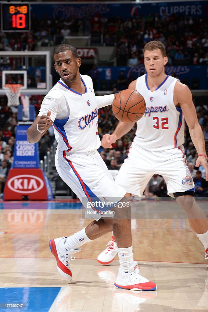 Chris Paul #3 of the Los Angeles Clippers dribbles the ball ahead of teammate Blake Griffin #32 during a game against the Atlanta Hawks at Staples Center on March 8, 2014 in Los Angeles, California.