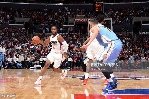 Chris Paul of the Los Angeles Clippers dribbles the ball Denver Nuggets at STAPLES Center on October 02 2015 in Los Angeles California NOTE TO USER...