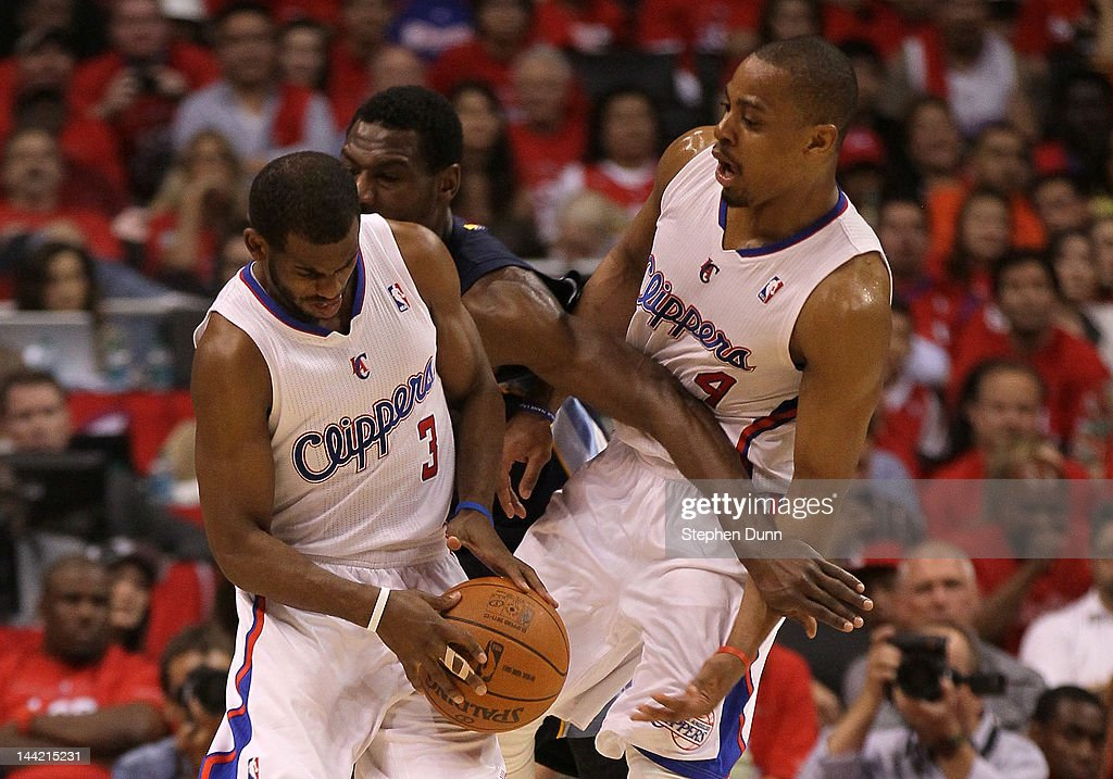 Chris Paul of the Los Angeles Clippers dribbles the ball into Tony Allen of the Memphis Grizzlies and teammate Randy Foye of the Clippers in the...