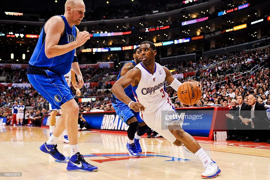<a gi-track='captionPersonalityLinkClicked' href=/galleries/search?phrase=Chris+Paul&family=editorial&specificpeople=212762 ng-click='$event.stopPropagation()'>Chris Paul</a> #3 of the Los Angeles Clippers drives against <a gi-track='captionPersonalityLinkClicked' href=/galleries/search?phrase=Chris+Kaman&family=editorial&specificpeople=201661 ng-click='$event.stopPropagation()'>Chris Kaman</a> #35 of the Dallas Mavericks at Staples Center on January 9, 2013 in Los Angeles, California.