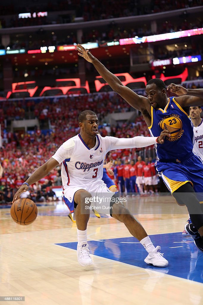 Chris Paul #3 of the Los Angeles Clippers drives against Draymond Green #23 of the Golden State Warriors in Game Seven of the Western Conference Quarterfinals during the 2014 NBA Playoffs at Staples Center on May 3, 2014 in Los Angeles, California. The Clippers won 126-121 to win the series four games to three.