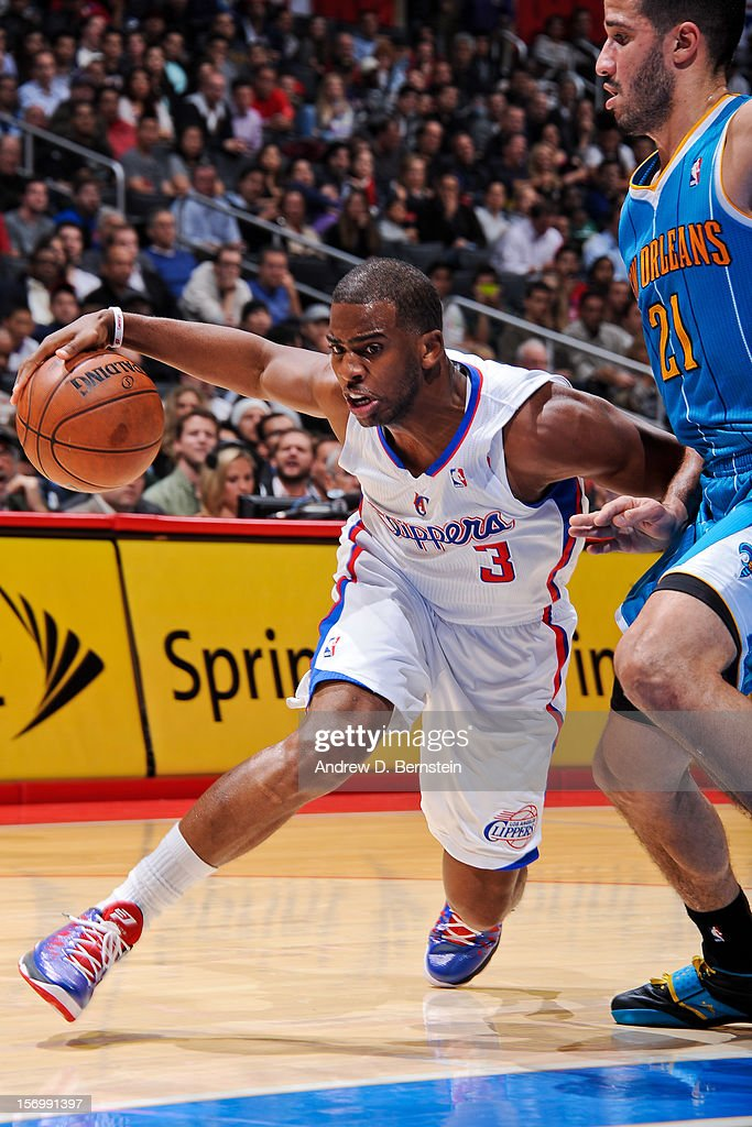Chris Paul #3 of the Los Angeles Clippers drives against Greivis Vasquez #21 of the New Orleans Hornets at Staples Center on November 26, 2012 in Los Angeles, California.