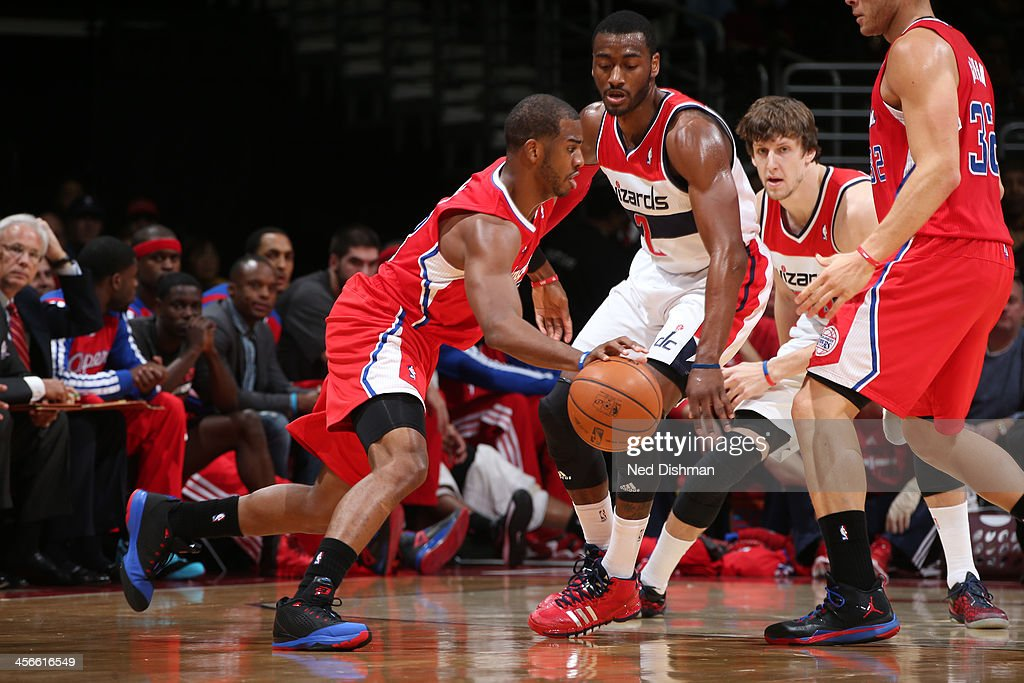 <a gi-track='captionPersonalityLinkClicked' href=/galleries/search?phrase=Chris+Paul&family=editorial&specificpeople=212762 ng-click='$event.stopPropagation()'>Chris Paul</a> #3 of the Los Angeles Clippers drives against John Wall #2 of the Washington Wizards during the game at the Verizon Center on December 14, 2013 in Washington, DC.