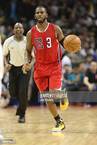 Chris Paul of the Los Angeles Clippers drives against the Charlotte Hornets as part of the 2015 NBA Global Games China at the MercedesBenz Arena on...