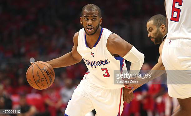 Chris Paul of the Los Angeles Clippers drives around a screen set by DeAnre Jordan to get past Tony Parker of the San Antonio Spurs during Game Seven...