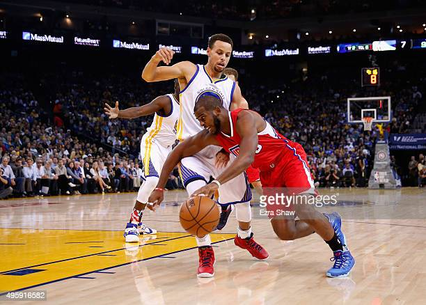 Chris Paul of the Los Angeles Clippers drives on Stephen Curry of the Golden State Warriors at ORACLE Arena on November 4 2015 in Oakland California...