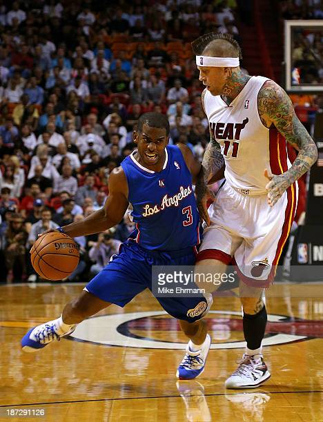 Chris Paul of the Los Angeles Clippers drives past Chris Andersen of the Miami Heat during a game at AmericanAirlines Arena on November 7 2013 in...