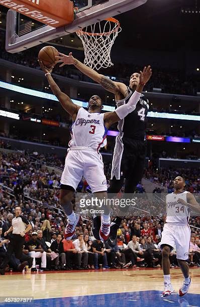 Chris Paul of the Los Angeles Clippers drives past Danny Green of the San Antonio Spurs for a layup in the first half at Staples Center on December...