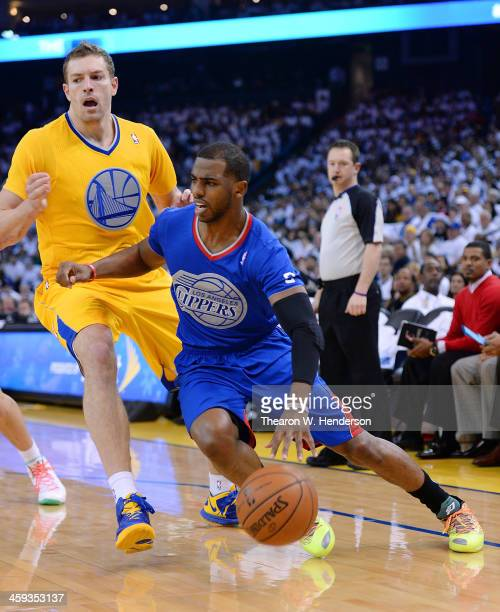 Chris Paul of the Los Angeles Clippers drives past David Lee of the Golden State Warriors during the first quarter at ORACLE Arena on December 25...