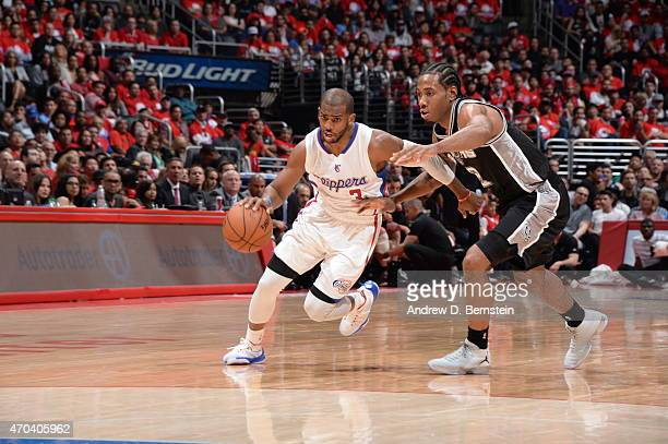 Chris Paul of the Los Angeles Clippers drives to the basket against Kawhi Leonard of the San Antonio Spurs in Game One of the Western Conference...