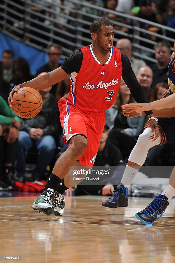 <a gi-track='captionPersonalityLinkClicked' href=/galleries/search?phrase=Chris+Paul&family=editorial&specificpeople=212762 ng-click='$event.stopPropagation()'>Chris Paul</a> #3 of the Los Angeles Clippers drives to the basket against the Denver Nuggets on March 17, 2014 at the Pepsi Center in Denver, Colorado.