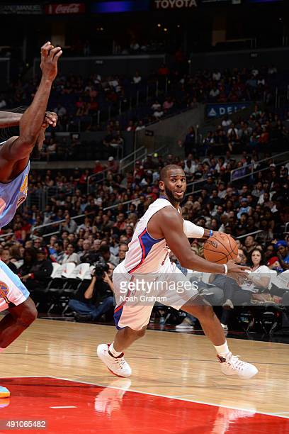Chris Paul of the Los Angeles Clippers drives to the basket against the Denver Nuggets during a preseason game on October 2 2015 at STAPLES Center in...