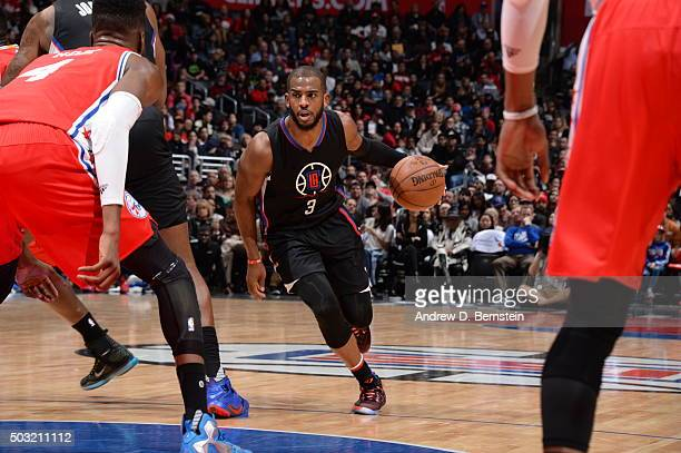 Chris Paul of the Los Angeles Clippers drives to the basket against the Philadelphia 76ers on January 2 2016 at STAPLES Center in Los Angeles...