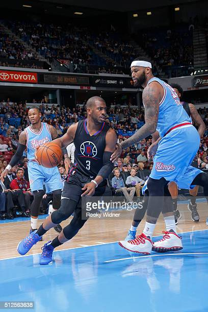 Chris Paul of the Los Angeles Clippers drives to the basket against DeMarcus Cousins of the Sacramento Kings during the game on February 26 2016 at...