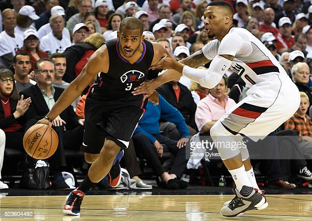 Chris Paul of the Los Angeles Clippers drives to the basket on Damian Lillard of the Portland Trail Blazers in the first quarter of Game Three of the...